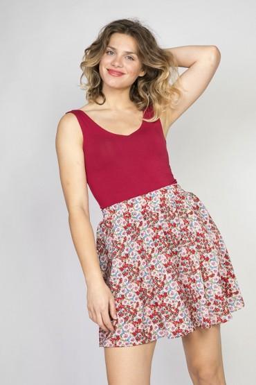 Falda mini rosa pastel con flores colores