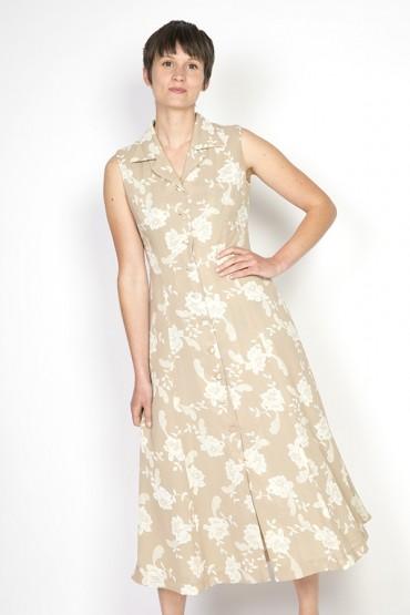 Vestido vintage beige con flores blancas