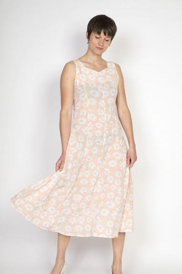 Vestido vintage rosa pastel con flores blancas