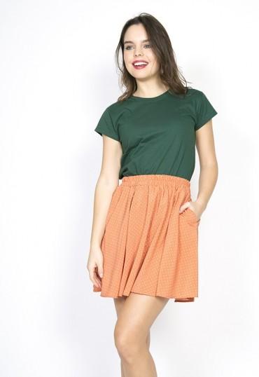 Falda mini naranja pastel...