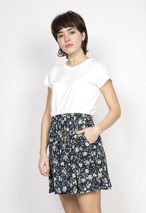 Falda mini azul marino con flores blancas y amarillas